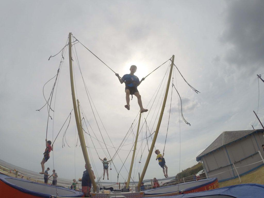 Children having fun on bungee trampoline